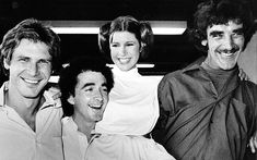 13 Throwback Photos of Harrison Ford | Harrison Ford, Anthony Daniels, Carrie Fisher and Peter Mayhew during a break from filming a television special presentation | EW.com