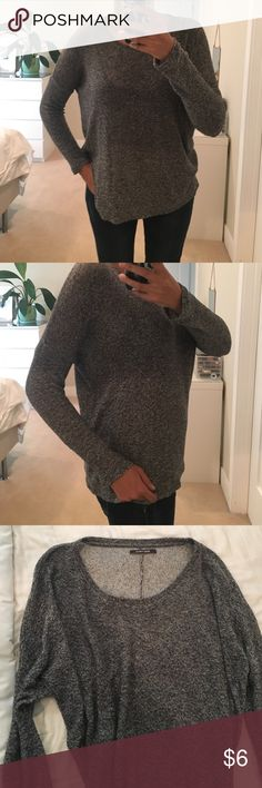 Round neck sweater This kitted black and white sweater is great for layering. It's very comfy, cool and has a cute seam detail at the back. As the inside is lighter I love to roll up the sleeves. It runs between M and L pieces Sweaters Crew & Scoop Necks