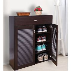 Buy Frisco Engineered Wood Shoe Rack in Wenge Colour by HomeTown online at Best Price. Shop Engineered Wood Shoe Rack in Wenge color from amazing designs. Avail discounts upto 50% on Shoe Rack which will elevate the decor of your house. ✔Fast Shipping ✔Easy Finance Options ✔Free Assembly. You can check out more shoe rack at HomeTown.in Shoe Cabinet Design, Wooden Shoe Cabinet, Shoe Cupboard, Wall Mounted Shoe Rack, Wood Shoe Rack, Shoes Stand, Stand Design, Engineered Wood