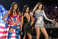 Taylor Hill, Selena Gomez, and Megan Puleri dance together during the 2015 Victoria's Secret Fashion Show at Lexington Avenue Armory on November 10, 2015 in New York City.
