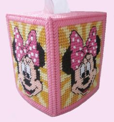 This tissue box cover features the ever so popular Minnie Mouse. All four sides are the same. All little girls love Minnie, a great addition for their night stand in their bedroom. You must choose from either, blue. yellow or lavender background from the drop down menu provided. If you want a color not listed, let me know. See photos Fits a regular size boutique style tissue box. A NEW BOX OF TISSUES WILL BE INCLUDED!  Made of 4-ply acrylic yarn over plastic canvas.. Lovingly hand stitched…