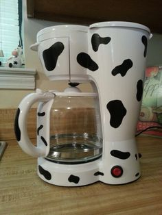 White coffee pot with black duck tape for cow spots!