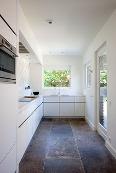 Nice earthy floor against a white modern kitchen.  But probably only works if the kitchen is very close to nature like this one (Het Atelier - Interieur (Hooglede, West-Vlaanderen) | project: RECOLLETTENSTRAAT)
