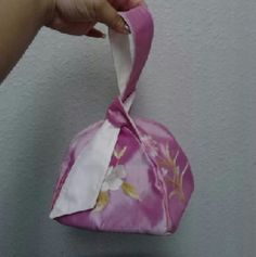 Flash 1 hour sale Nwt pink asian wristlet bag Purchased from Kailua Beach walk a boutique store in Hawaii. One of a kind. NWT. Beautiful just never had the chance to use. Button closure, hidden by a fashionable strap that wraps around your wrist for easy carrying. Dance the night away. Great for a formal or wedding Bags Clutches & Wristlets