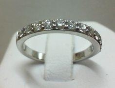Custom band with diamonds halfway around.