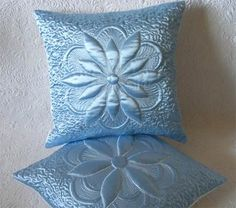taffeta quilted pillows - see trapunto stitch as well.