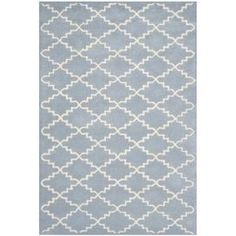 Anchor neutral furniture or add geometric appeal to a vibrant room with this hand-tufted wool rug, showcasing a classic trellis motif.    Product: RugConstruction Material: 100% Wool pileColor: Blue and ivoryFeatures: Hand-tufted in India Note: Please be aware that actual colors may vary from those shown on your screen. Accent rugs may also not show the entire pattern that the corresponding area rugs have.Cleaning and Care: Professional cleaning recommended