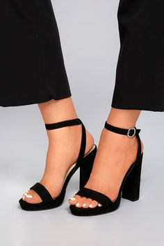 "For the perfect, classically cute heels, look no further than the Katie Mae Black Suede Platform Ankle Strap Heels! Soft vegan suede shapes a peep-toe upper (with 0.5"" toe platform), that carries into a crisscrossing ankle strap with silver buckle."