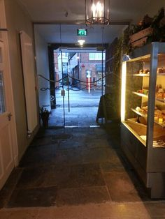 The beautiful entrance to The Salutation Inn Topsham Devon & pastry chef Sylvan's creations on display. Pubs And Restaurants, Pastry Chef, Devon, Entrance, Trips, Display, Business, Green, Beautiful
