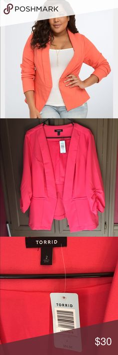 Torrid coral open blazer Stunning piece. It is a bright coral color. The first picture shows the peachy color but on the model. The second picture shows the true to color coral. Beautiful jacket. New with tags's. Size 2 from torrid. That's about a size 20/22 Torrid Jackets & Coats Blazers