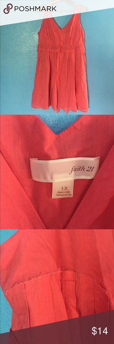 Faith 21 1X dress This 1X Faith 21 -Forever 21 plus size dress is a bright coral, has a lined skirt with some poof, raw edge and faded details on the deep V neckline, empire waist band with ties in back for comfort. Laid flat it measures 20 inches at bust, 19 inches at waist and 35 shoulder to hem. Side zipper enclosure and 100% cotton so not a lot of stretch. Gently used and from a smoke free home. Forever 21 Dresses Mini