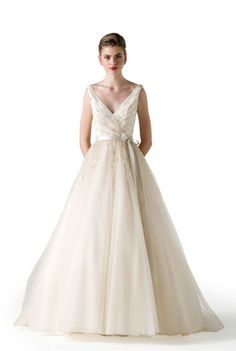 Anne Barge collection spring 2015. V-neck ball gown of tulle with draped bodice and scattered crystals and seed pearls throughout bodice and upper skirt.