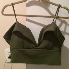 ⭐️NWOT Structured Crop Top⭐️ Super sexy and unique. Shows lots of cleavage. Boning in the v-neck. Spaghetti strap and wide strap that goes around upper arm. Zips in back. TTS. The strap busted when I tried it on in the store. I sewed it and you can hardly notice it when it's on! Comes with free gift. No trades. Fast shipping! Discount bundles! mandee Tops Crop Tops