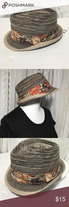 NWT Icing kids woven he Fedora hat Cute girls fedora hat. New with tags never worn. Has orange and green floral print sash around the hat. Inside of hat measures about 21 inches. Thanks for visiting my closet feel free to look around!🤗 icing Accessories Hats