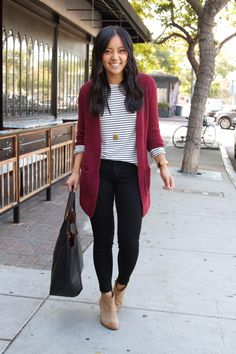 black and white striped shirt + maroon cardigan + black skinny pants + taupe booties + black tote + business casual outfit