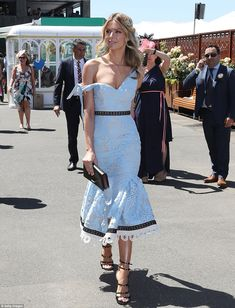 Ace in lace! Jennifer Hawkins once again led the style stakes as she attended Crown Oaks Day on Thursday in Flemington wearing a pastel blue fishtail dress by Talulah