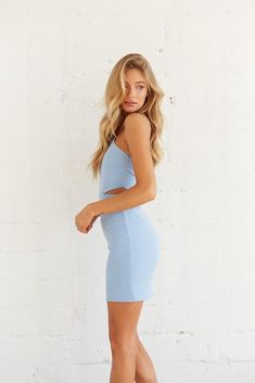 Hey dream girl, you'll definitely turn heads in our Naomi Halter Cut Out Mini Dress! This piece is complete with a tie back halter neckline, cut outs at the waist for an extra glimpse of skin, and a fitted silhouette for a bodycon fit. Available in white and chambray blue. Pair with our Briar Strappy Heel In Black for an elegant final touch! Sorority Rush, Halter Mini Dress, Open Back Dresses, Strappy Heels, Dress Backs, Cut Outs, Size Model, Chambray, Blue Dresses