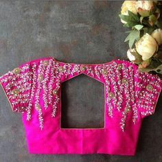 Blouse back neck designs are everything when it comes to picking a good blouse. Here are 40 latest blouse back neck designs that will inspire you to stitch the best blouse for your big day! Blouse Back Neck Designs, Cutwork Blouse Designs, Wedding Saree Blouse Designs, Hand Work Blouse Design, Simple Blouse Designs, Stylish Blouse Design, Hand Embroidery Designs, Embroidery Thread, Latest Saree Blouse Designs