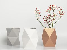 The geometric shapes of these vases ($17 each) look especially striking with sculptural berry branches or craspedia.