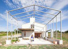 Stone gabled house in Spain extended with skeletal framework