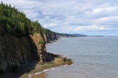 Photo about Dramatic cliifs of Cape Enrage along the Bay of Fundy, in New Brunswick, Canada. Image of landscape, rugged, fundy - 15571979 Canada Pictures, New Brunswick Canada, Landscaping Images, Nova Scotia, Landscape, Beach, Places, Water, Amethyst Crystal