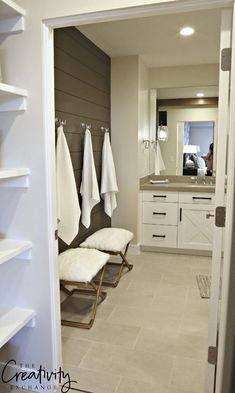 Painted shiplap accent wall in bathroom.