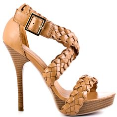 Bring this braided beauty to your wardrobe!  Just Fabulous showcases Annika with its winding braided straps and adjustable ankle strap.  This open toe sandal delivers a tan fabric upper, 5 inch stiletto heel and 1 inch platform.
