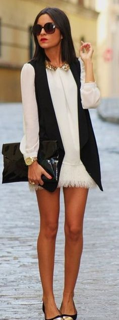 Love a classic mini dress with long sleeves. It's so 60's chic and the black vest is a fun addition to it. Super cute.