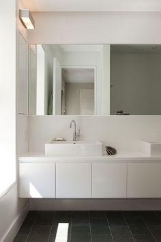 corian vanity top; green cleft slate tile floor