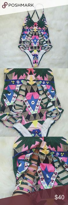 Trible One-Piece Brand new without tags. Padded top. True to size small. Bottoms are slightly cheeky and a criss -cross back Really great fitting swimsuitn Swim One Pieces