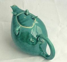 Ceramics by John Townsend at Studiopottery.co.uk - 2011. Man falling through teapot