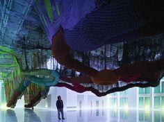 ERNESTO NETO O Bicho SusPenso na PaisaGen,2011 polypropylene thread crochet, polypropylene balls and stones 7.35 x 44.65 x 21.45 m Installation view, Hiper Cultura Loucura en el Vertigo del Mundo, Faena Arts Center, Buenos Aires, 2011-2012