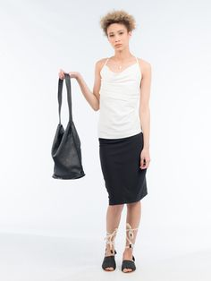 Keep your look simplistic yet modern with this Spaghetti strap blouse. Spring or summer will be the season to show off this piece. It has a straight cut , with ruffling detail along the neckline and spaghetti straps, and is a comfortable fit Straight Cut, You Look, Spaghetti Straps, Ballet Skirt, Neckline, Seasons, Detail, Blouse, Spring