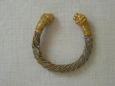 Gold and blue glass bracelet with lion head finials Greek 4th-3rd century BCE
