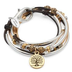 The Harperwith goldplate tree of lifecharm combines sterling silverplate and 24kt goldplate crescents into a uniqueleather wrap charm bracelet & necklace