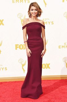Sarah Hyland wears an off-the-shoulder gown by Zac Posen with statement earrings