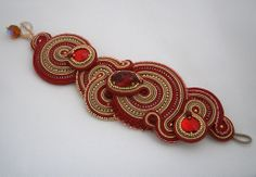 Red and gold-colored soutache bracelet with red Swarovski crystals