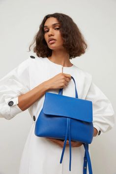 Soft and textured calf leather is sculpted into our new Soft Lady Bag, a reimagined counterpart to our iconic Lady Bag. The interior features a luxurious suede lining and interior compartments for added functionality. The adjustable and removable shoulder strap allows this relaxed bag to be carried crossbody or by hand. Leather Crossbody Bag, Leather Backpack, Leather Conditioner, Bago, Blue Bags, Bag Sale, Calf Leather, Bucket Bag, Fashion Backpack
