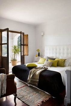 ibiza, spain via style files  love the dark french doors and the light walls with light upholstered bed.