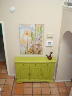 Fantastic lime green hutch and a Rex Ray print distract from the doorbell/home alarm wall.