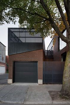 Naturehumaine adds black and yellow staircase to Montreal home