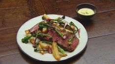 Curtis Stone's porterhouse steak is accompanied by pickled onions, a creamy bearnaise sauce, hearty beef fat potatoes and charred broccolini. Mustard Seeds, Steak, Potatoes.