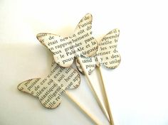 18 Butterfly cupcake toppers featuring vintage French text, via Etsy