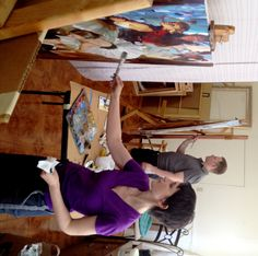 Michael and Inessa Garmash - the artists at work, hand embellishing two limited edition fine art prints on canvas.