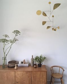 Picture by Tessa Hop. Hanging Mobile Brass by Lappalainen