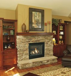stone fireplace with built in bookcases | View the entire photo gallery for Alpine Fireplaces