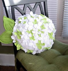 white and green decorative cushion with floral designs
