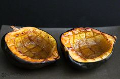 Easy baked acorn squash recipe, perfect for the fall.  Squash is cut in half, insides scooped out, then baked with a little butter, brown sugar, and maple syrup.