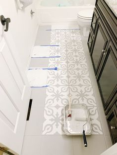 How to Paint Tile Floors arinsolangeathome Home Deco arinsolangeathome floors Paint painted floor tiles tile Painted Bathroom Floors, Stenciled Tile Floor, Painting Bathroom Tiles, Painting Tile Floors, Bathroom Floor Tiles, Painted Floors, Tile Bathrooms, White Tiles, White Tile Floors