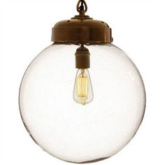 bulb inside a globe pendant.  Bet I could rig something similiar together that didn't cost the $660 they're charging!